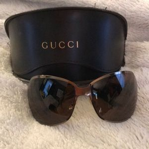 GUCCI Brown Curved Sunglasses w/ Buckle Detail